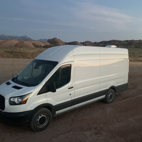 Gorgeous Ford Transit with high top van 170 Extended.