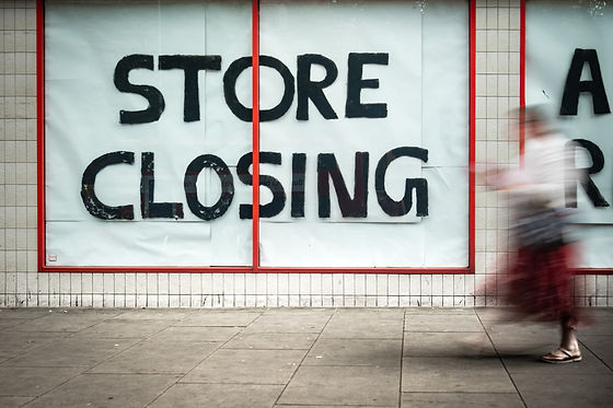 High Street 'Store Closing' sign with mo