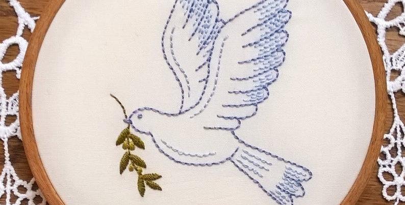 kit de broderie traditionnelle -  colombe de la paix sur fond blanc