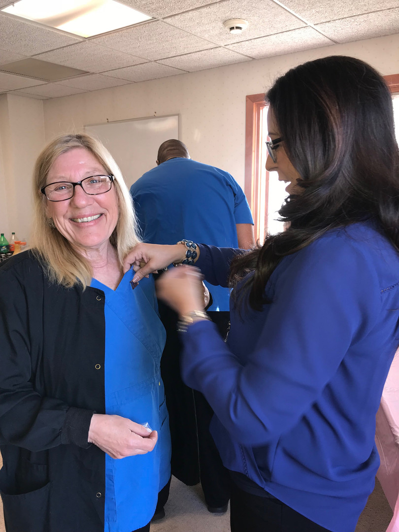 Patricia L. pins Lorraine for years of service