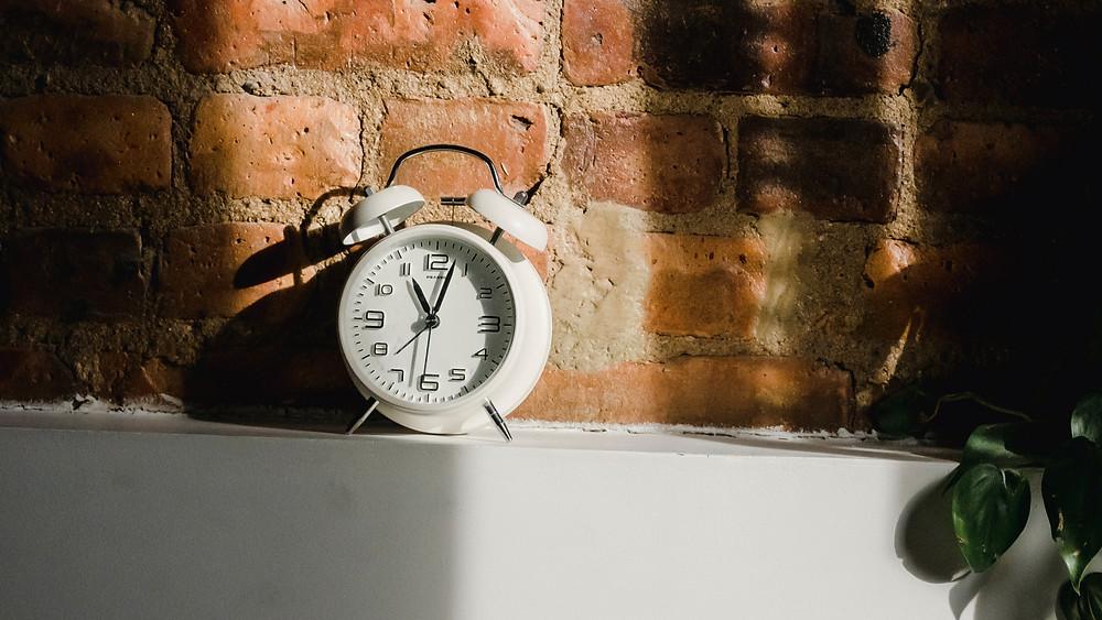 Clock sitting on a ledge.