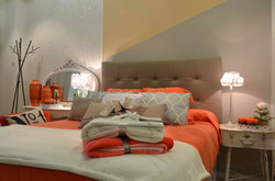 Dormitorio en coral