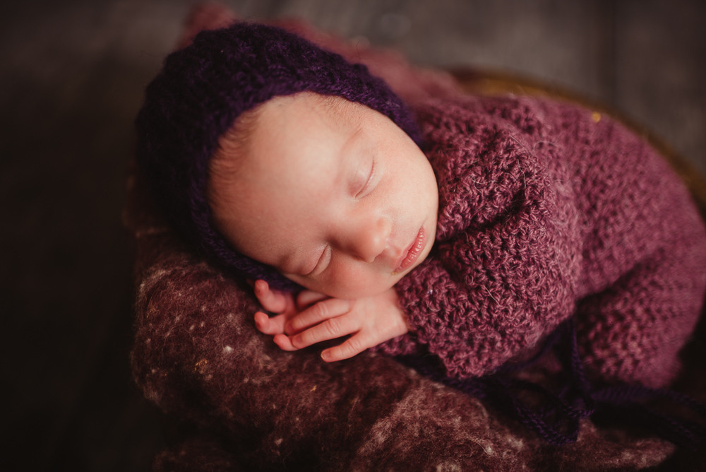 newborn girl purple bonnet