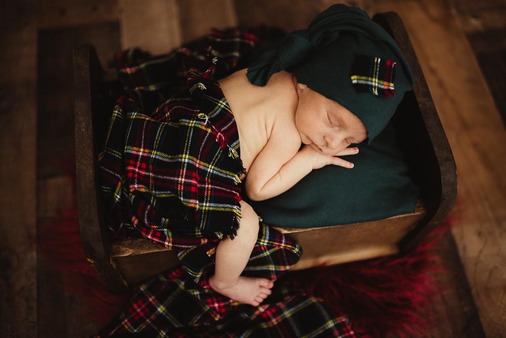 newborn boy posed