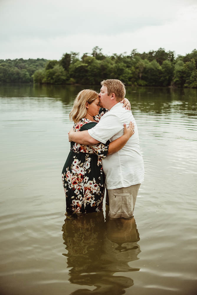 husband and wife in water hugging