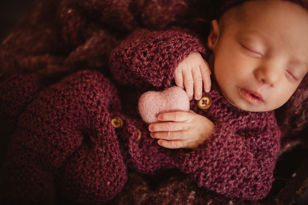 newborn girl felt heart