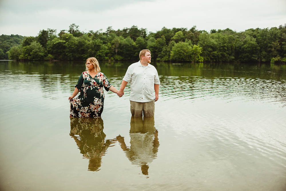 husband and wife in water holding hands