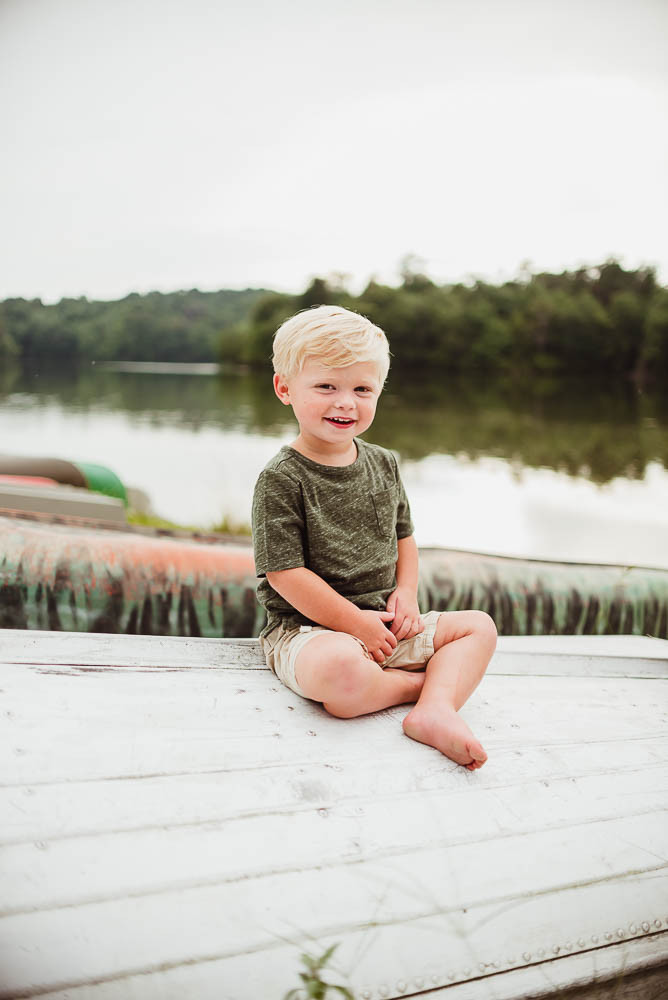 toddler boy on boat waterfront