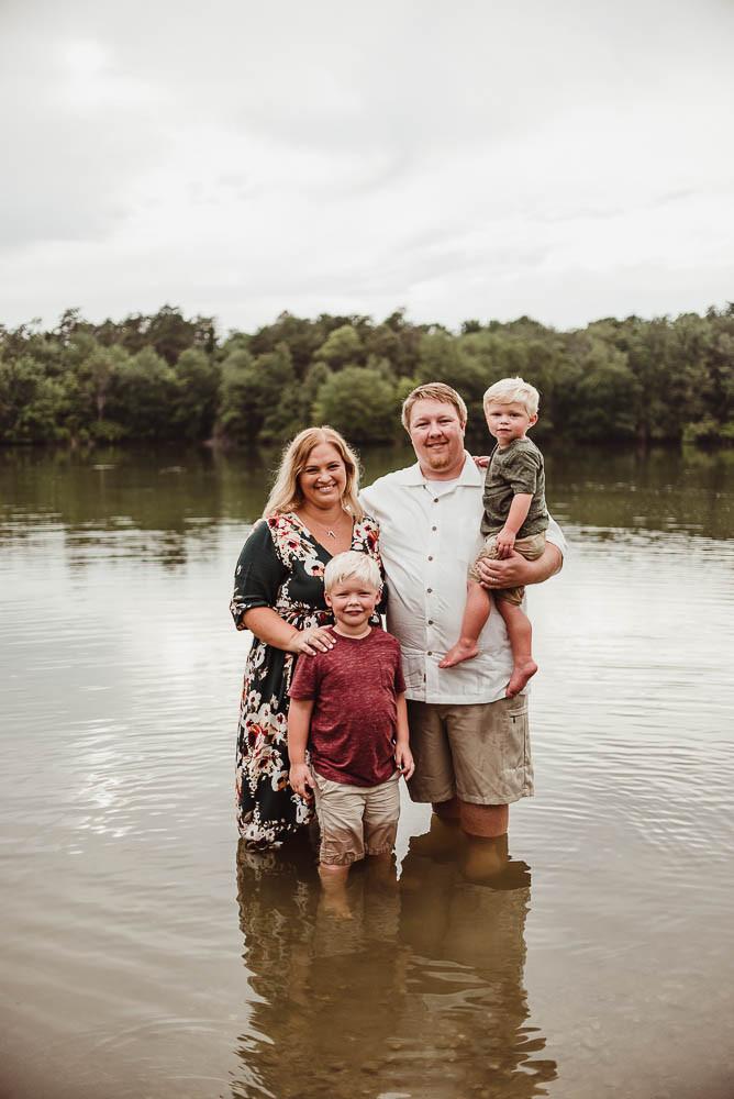 family posing in water