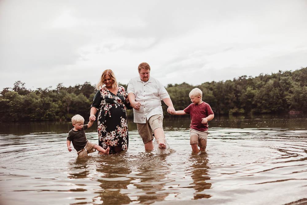 family splashing in water