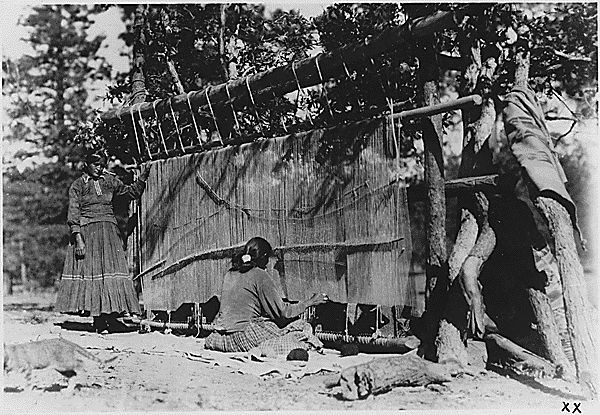 Navajo women weaving one of the very large rugs for which Southern Navajo (Ganado district) Indians are famous, 1933