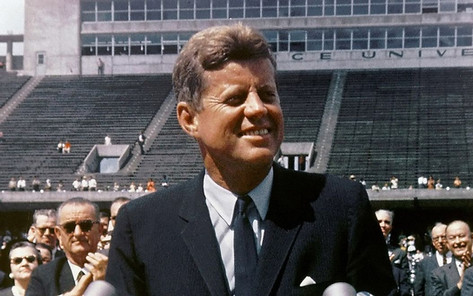 Kennedy speaking at Rice University in Houston on September 12, 1962. Vice President Lyndon B. Johnson can be seen behind him