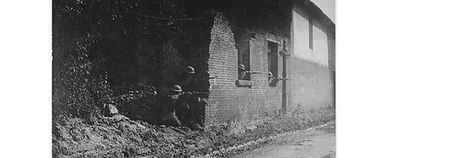 US Sharpshooters have good view of enemy from shelter behind old brick wall. 28th Infantry, Bonvillers, France, 1918