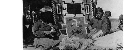 Carding wool to be used in Navajo Indian rug weaving, 1933