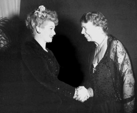 Photograph of Lucille Ball and Eleanor Roosevelt during a tour of Washington, D.C., hotels presenting fundraisers for the President's Birthday Ball to fight infantile paralysis, 1944
