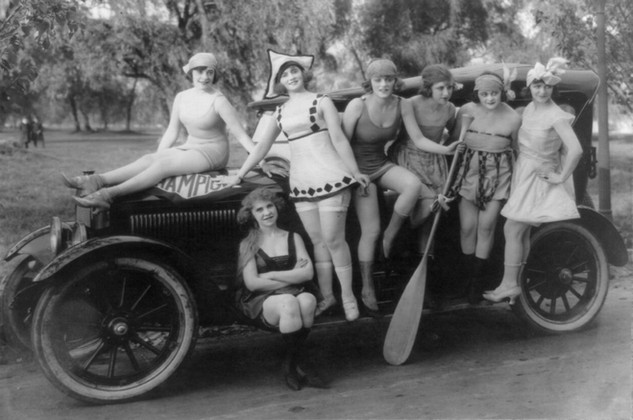 Mack Sennett's bathing beauties posed on automobile, c1920s
