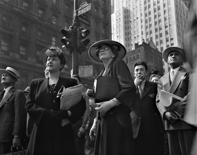 Crowds of onlookers read news of the Allied invasion of Normandy on an electric marguee in Times Square on D-Day June 6, 1944