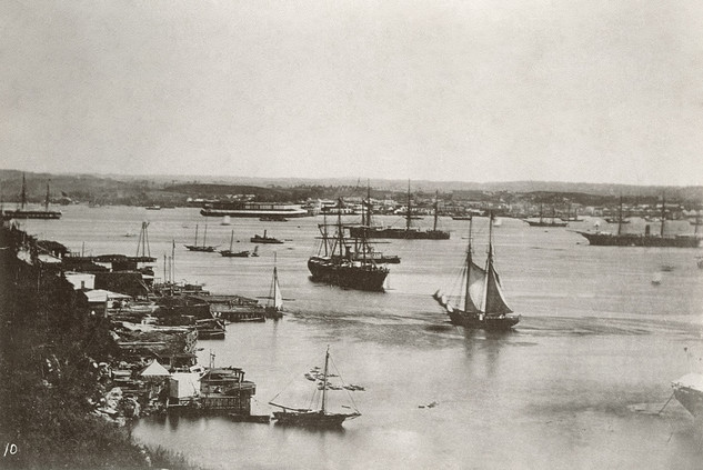 Havana Harbor, showing men-of-war, transports, ocean steamships, row boats, and sailing vessels anchored in the bay, 1898
