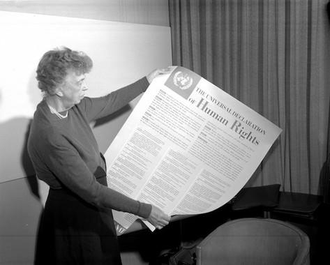 Eleanor Roosevelt examines The Universal Declaration of Human Rights, 1948