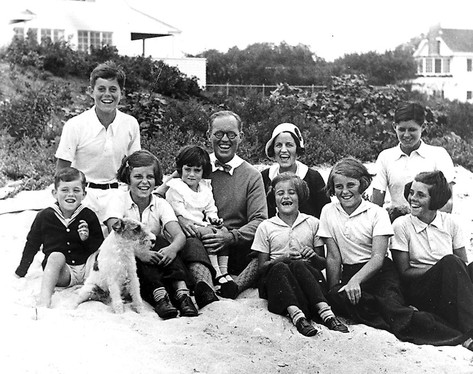 The Kennedy family in Hyannis Port, Massachusetts, with JFK at top left in the white shirt, 1931