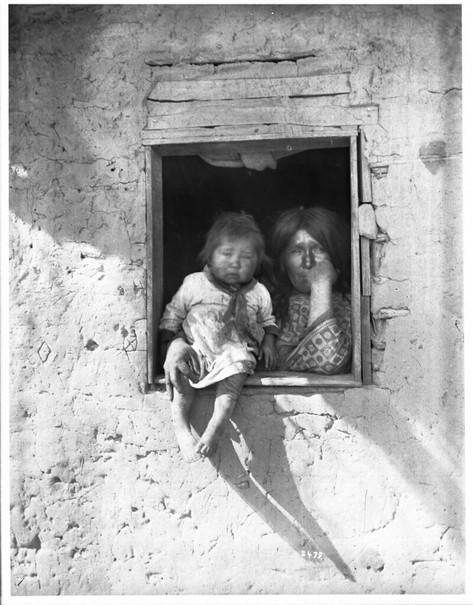 Yuma Indian mother and baby at the window of their dwelling, ca.1900