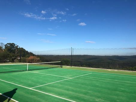Installation of new sliding tennis court surround curtains in Elanora Heights