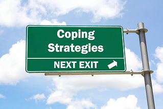 Green overhead road sign with a Coping S