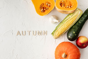 autumnal-fruits-and-vegetables-on-white-