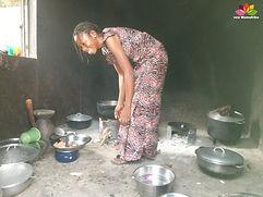 Isatou cooking