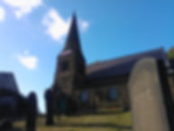 Greentop church building with gravestones in foreground