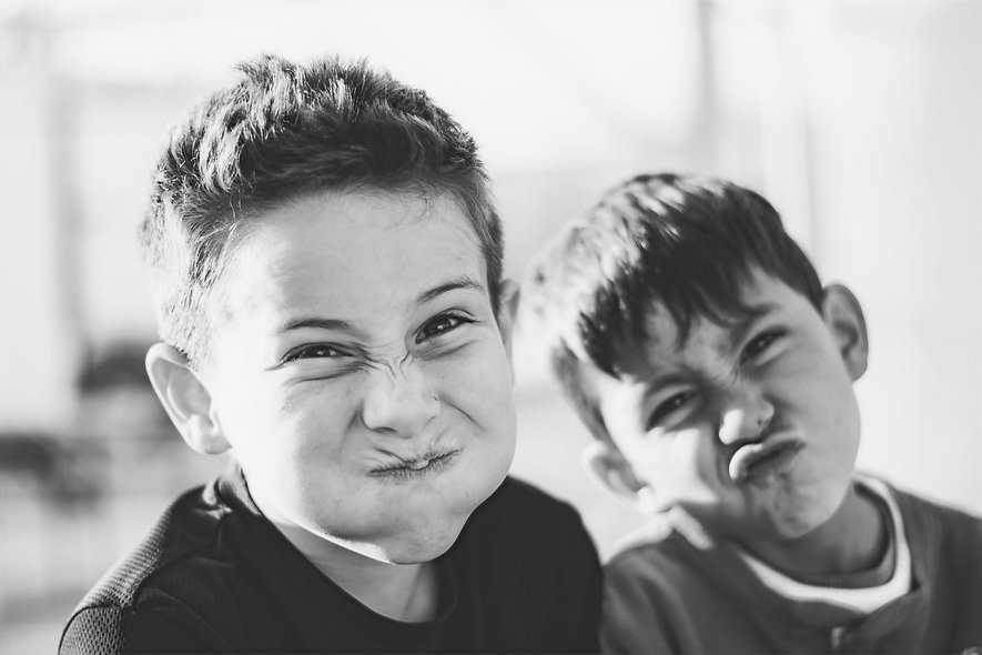 headshot-two-boys-making-funny-faces