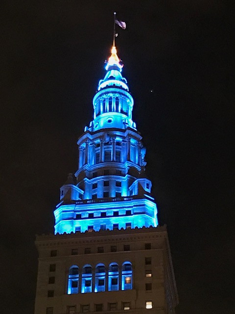 building-lit-with-teal-blue-allergy-awareness