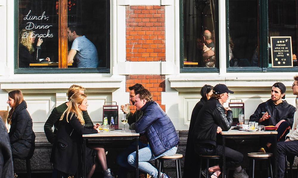people-sitting-at-tables-outside-restaurant