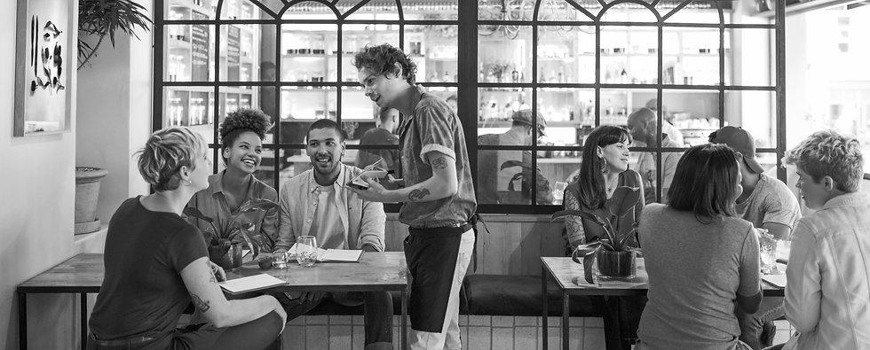 friends-restaurant-speaking-with-waiter