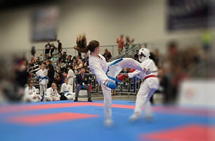 girl-karate-kicks-opponent-in-karate-competition