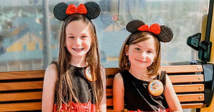 two-little-girls-with-mickey-mouse-hats-smile