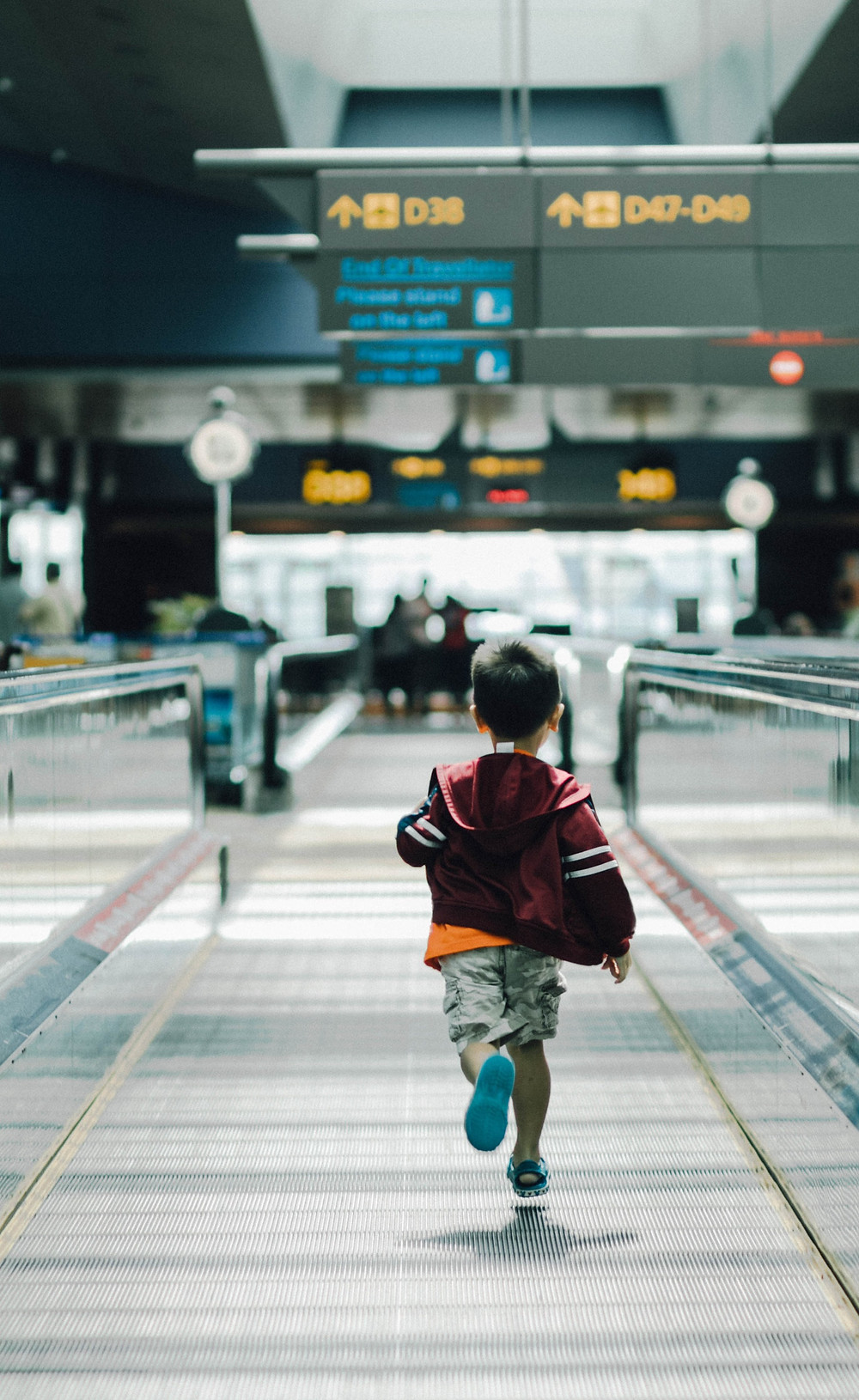 small-boy-running-in-airport-departure-area
