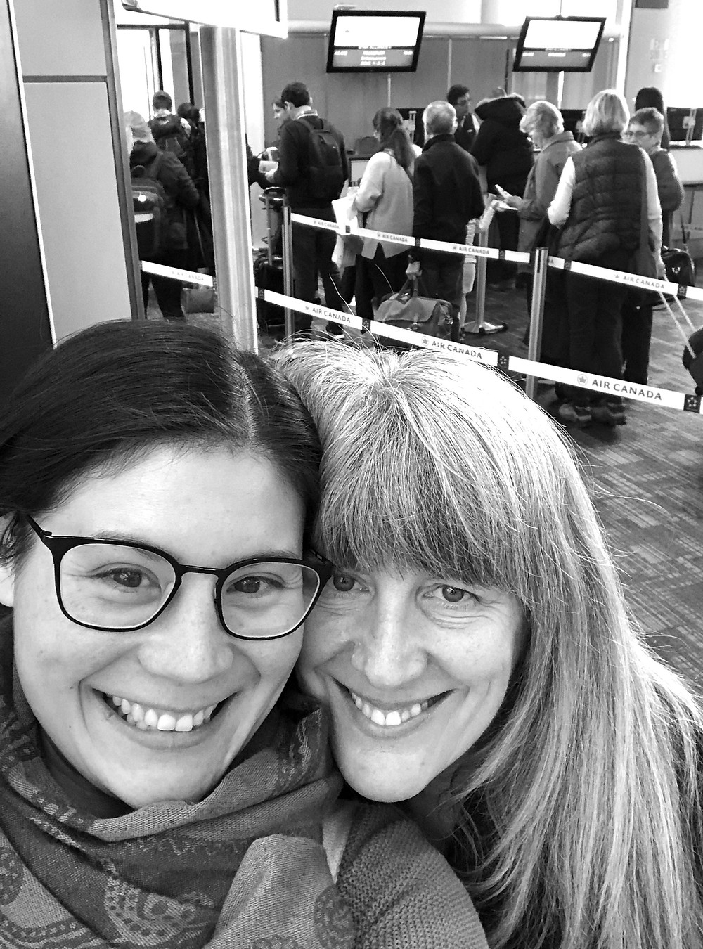 smiling-mother-daughter-at-airport