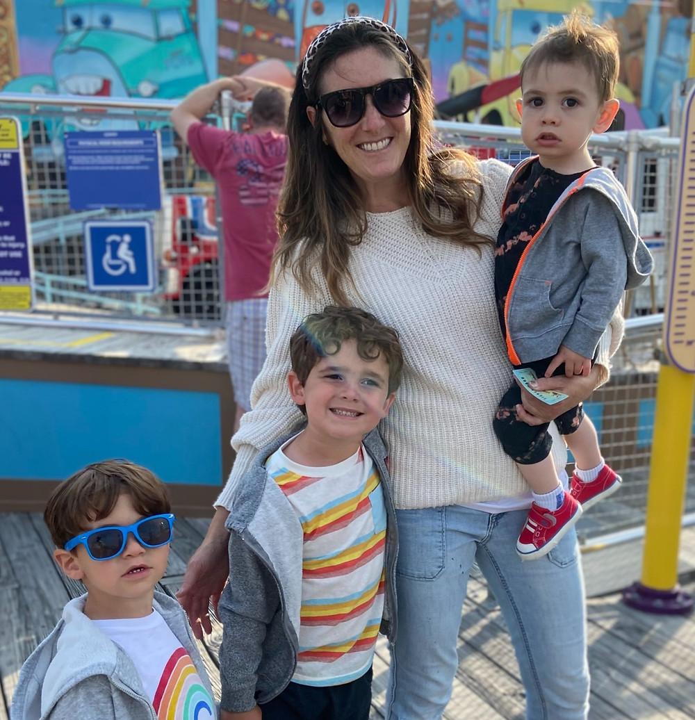 lauren-foti-author-with-three-little-boys-at-amusement-park