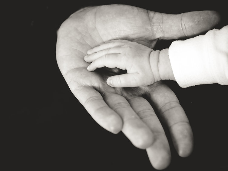 baby-hand-resting-on-open-palm-of-parent-hand