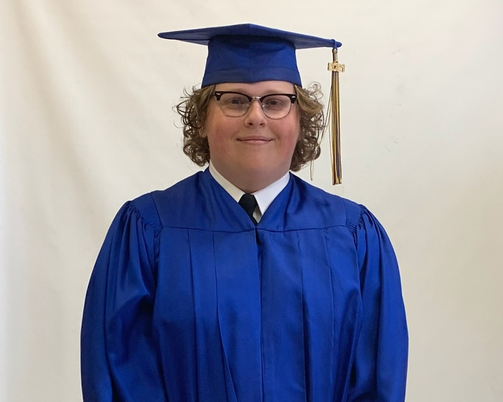 high-school-boy-graduate-blue-cap-gown