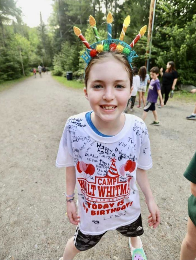 young-girl-at-camp-with-birthday-crown-smiles