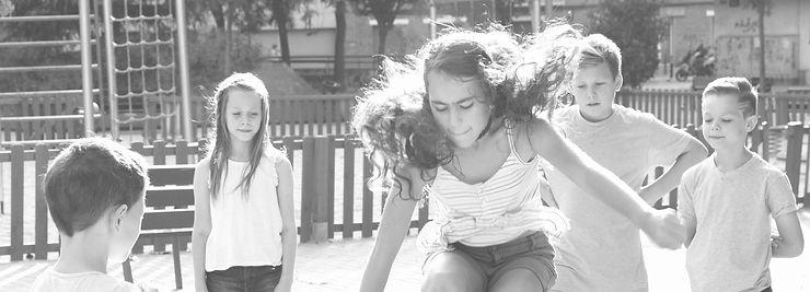 kids-watching-girl-with-dark-curly-hair-jump-rope