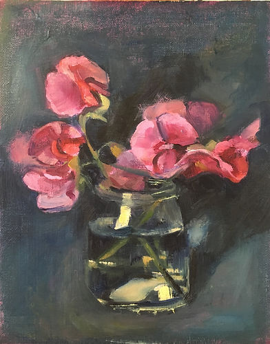 Small pink Sweet peas in a glass jar