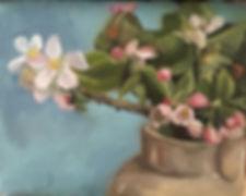 Scented English apple blossom in a cream jug