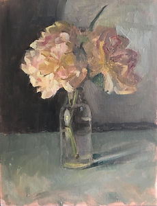 Pale pink Roses in a small glass bottle