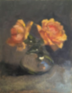 Small little tangerine garden Roses in a glass vase