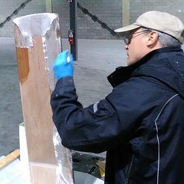 Fiberglass being applied to new rudder