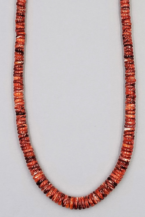 Dark orange spiny oyster with red highlights