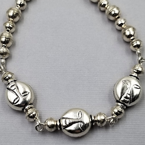 Sterling silver bracelet with (3) whimsical face beads